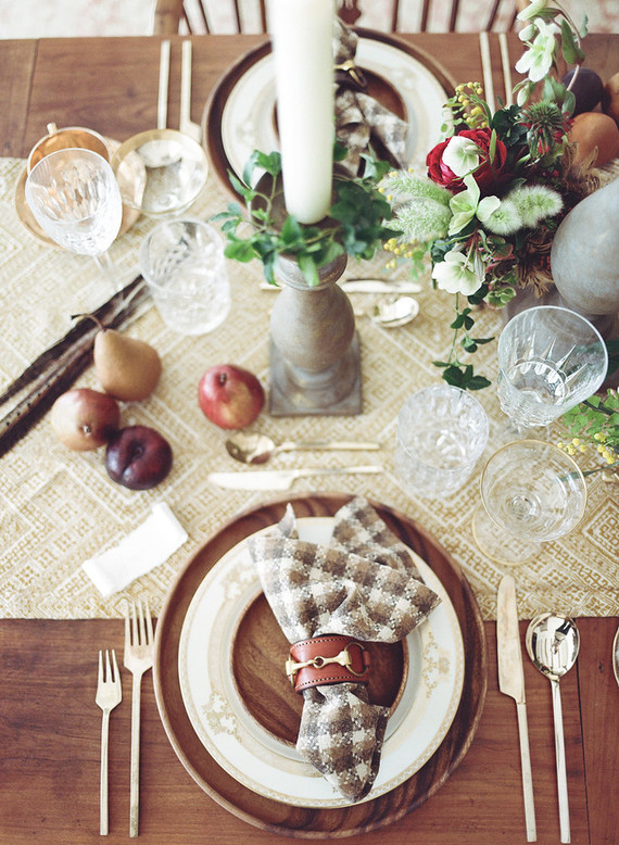 Wooden chargers, plaid napkins, a fabric table runner and fruit make it comfier
