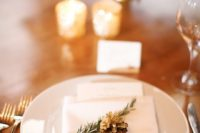 10 a pinecone and an evergreen sprig are the perfect accents