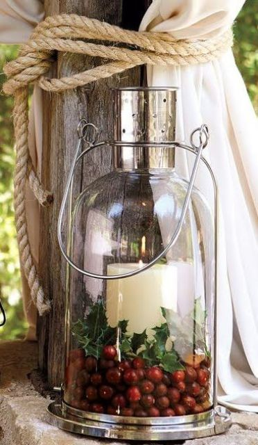 candle lantern with cranberries