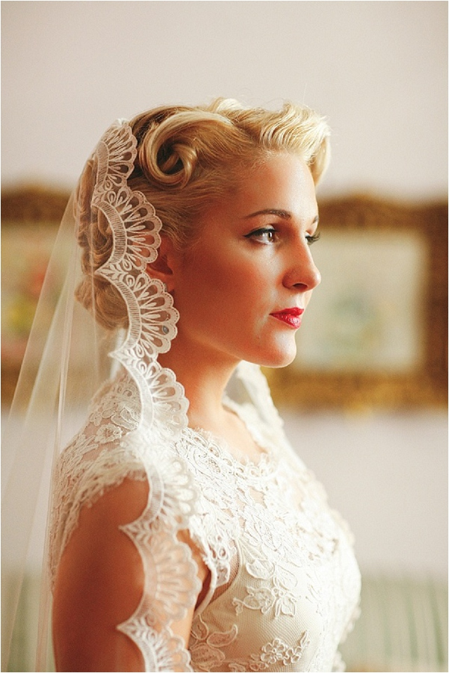 curled updo wwith a mantilla veil