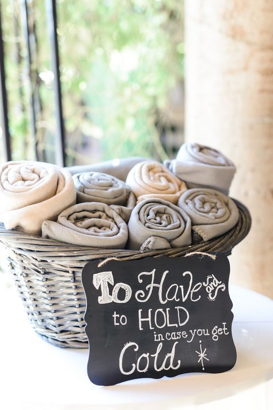 favor blankets in a basket for guests