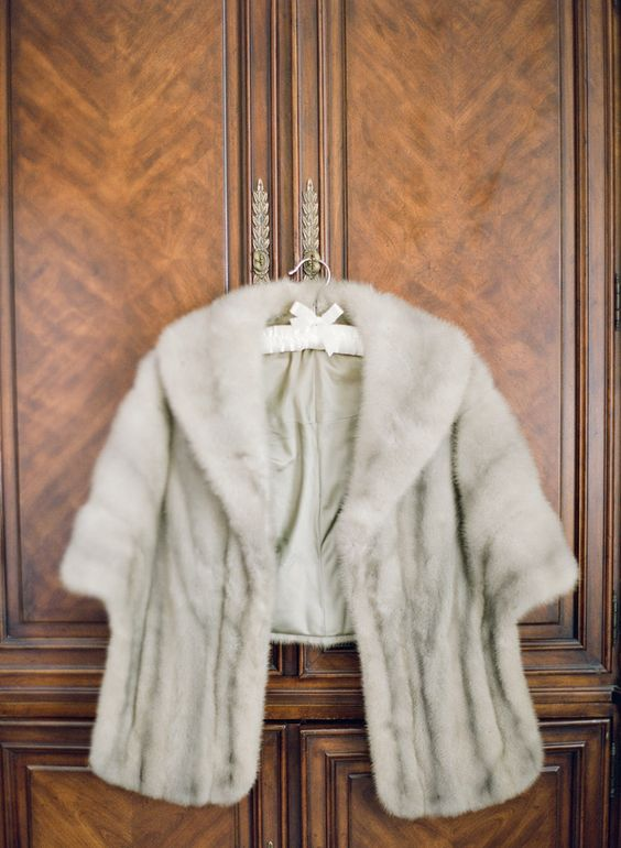 grey faux fur cover up makes your bridal look elegant