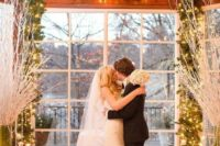10 lit up fir garland used as an indoor wedding arch is a nice and simple idea for any winter celebration
