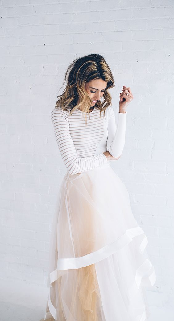 tulle maxi skirt with edging and a white sweater