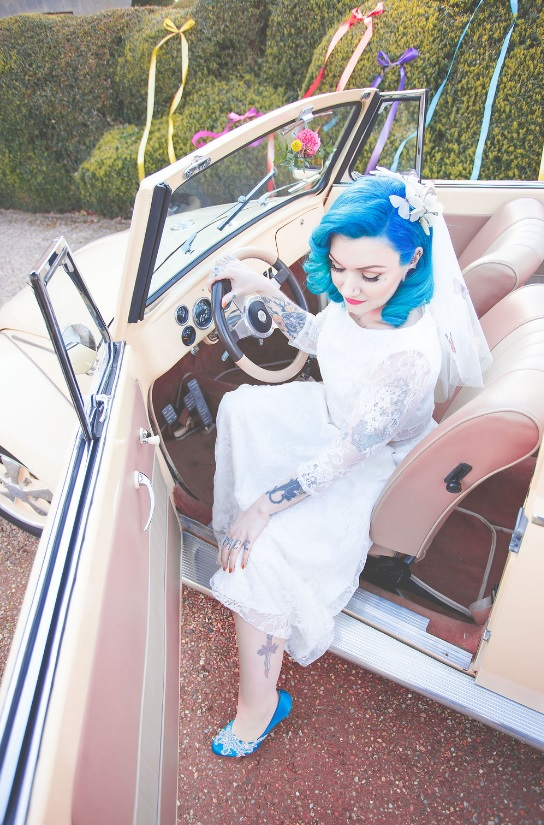 A retro car added to the shoot theme, and the bride's tattoos made her look pop