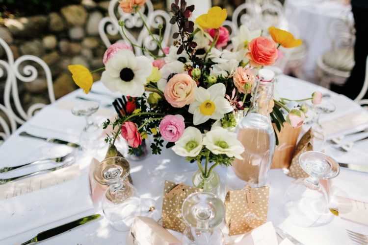 The reception was airy and cute, with boho chic touches and bold flowers