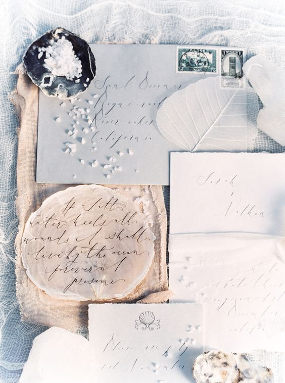 coastal wintry wedding stationery with calligraphy