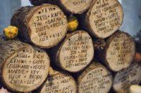 11 woodland wedding seating chart burnt on wood logs