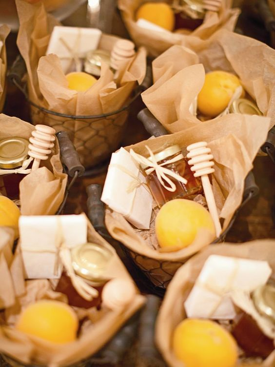 French wired basket wedding favors filled with fresh apricots, honey and local cheddar cheese