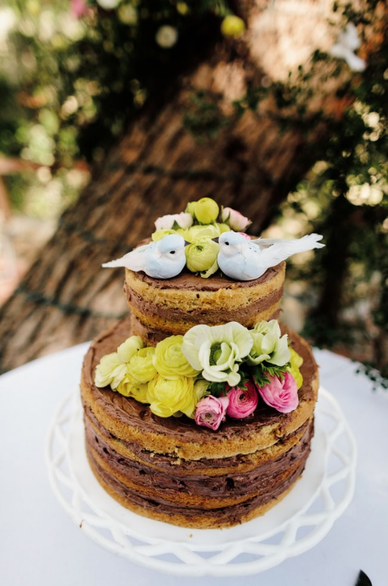 The cake was a naked one decorated with natural flowers