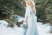 12 blue is a trendy color for wedding dresses and it look cool in snow
