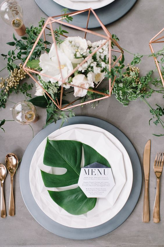copper metal geo centerpieces with freshflowers and greenery