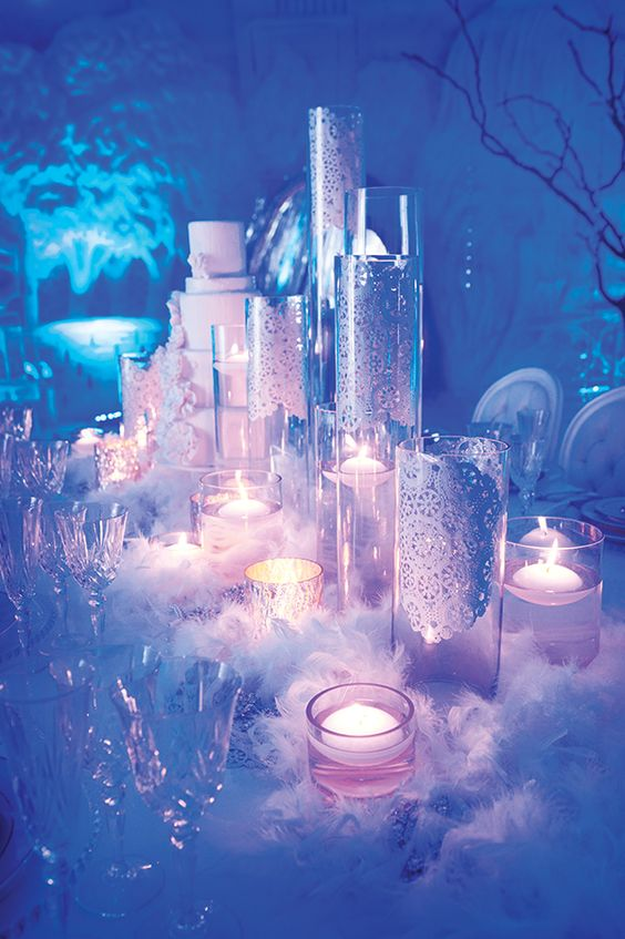 feather boas nestled between the candles to create winter decor