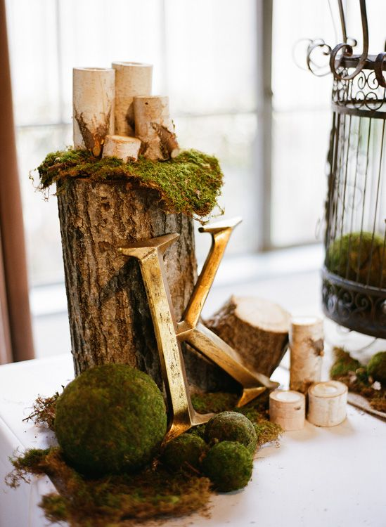 moss, logs and candles for decorating tables
