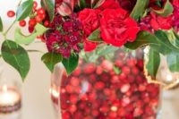 12 red flowers and cranberries in the vase to rock