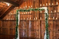 12 simple eucalyptus garland wedding arch for a barn wedding and candles around for an ambience
