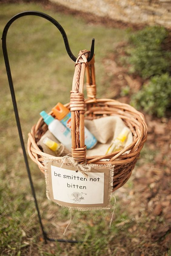 basket with bug sprays and a burlap sign