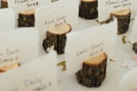 13 wood log place card holders are perfect for woodland and rustic nuptials