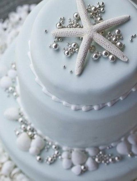 beach cake with a star fish and pearls in light blue