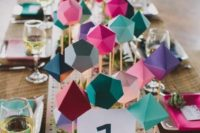 14 colorful folded paper table runner for a geometric tablescape