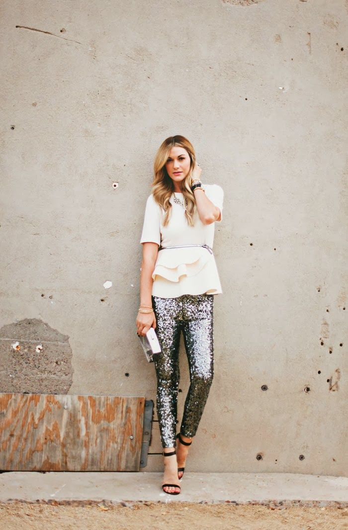 sequin pants, a white peplum top and heels
