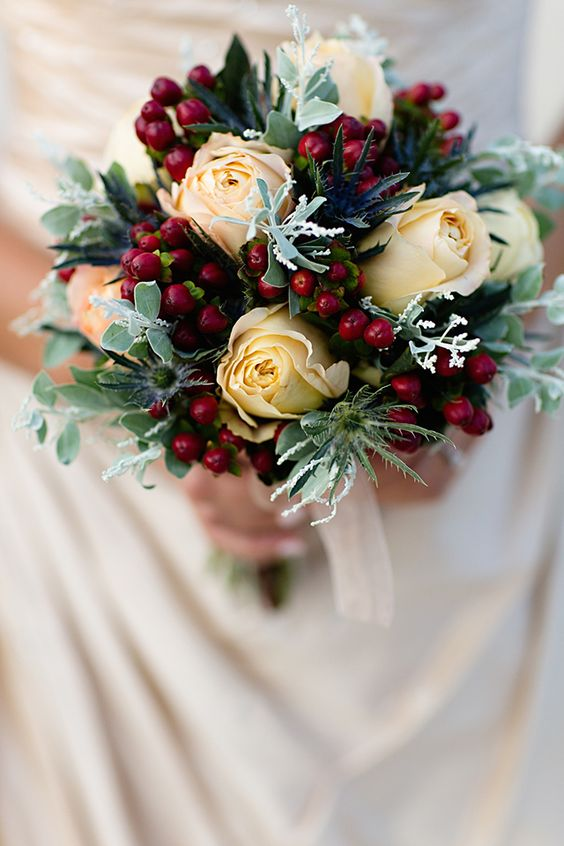 ivory roses, thistle and cranberries for an oirignal bouquet