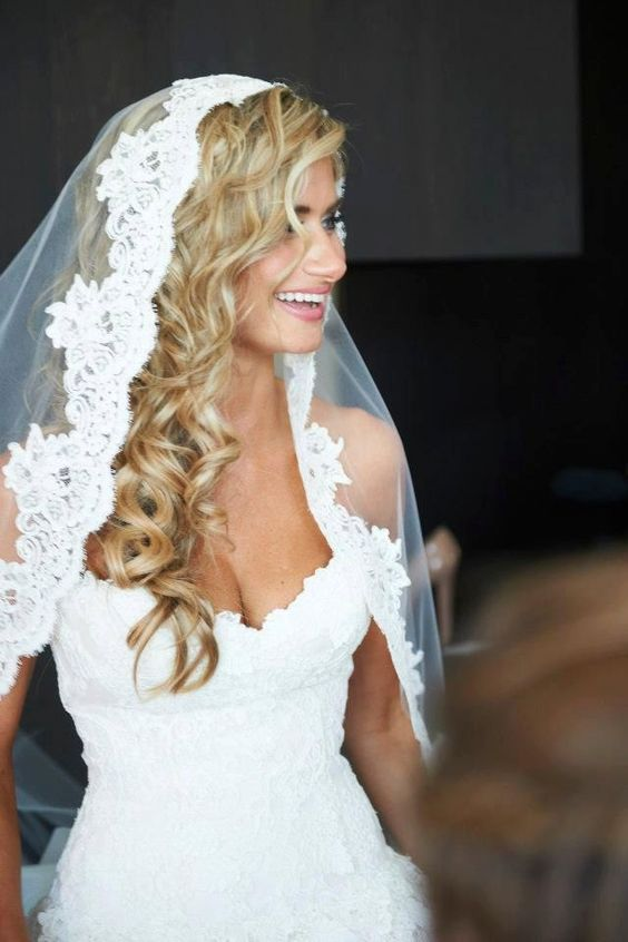 36 beautiful hairstyles to rock with veils weddingomania long curls down with a mantilla veil is always a win junglespirit Images
