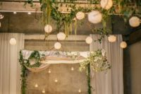 15 wedding chuppah with greenery, hanging candle holders and candle lanterns for indoors