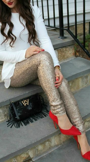 white sweater, sequin pants and red heels