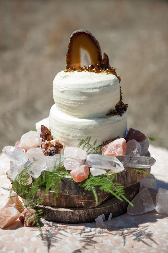 a geode cake topper and crystals for decor are great for a boho or rustic wedding