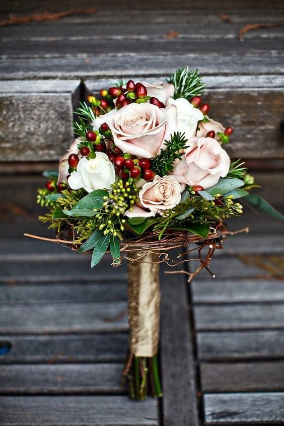 a rustic wintry bouquet with cranberry accents