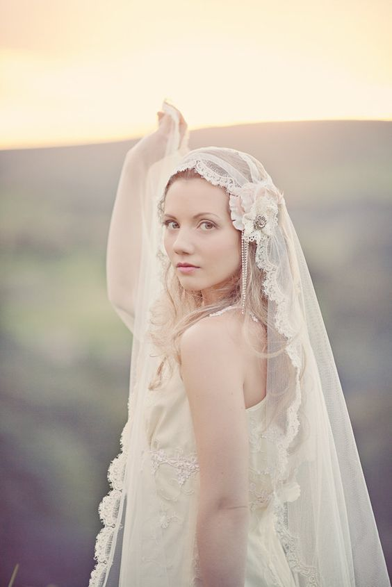 long hair down, a mantilla veil and a fabric hairpiece