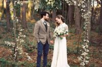 16 outdoor woodland boho wedding arch decorated with greenery and blooms