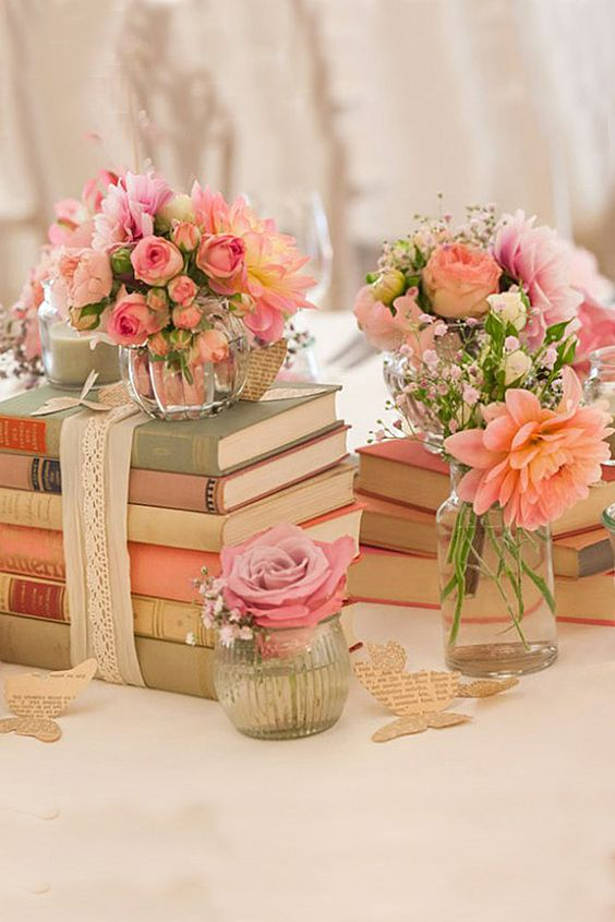 books bundles with lace and ribbon and topped with flowers