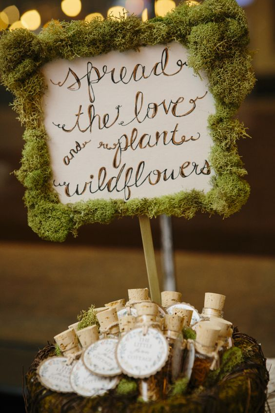 moss sign is a cool idea for a woodland or a rustic wedding