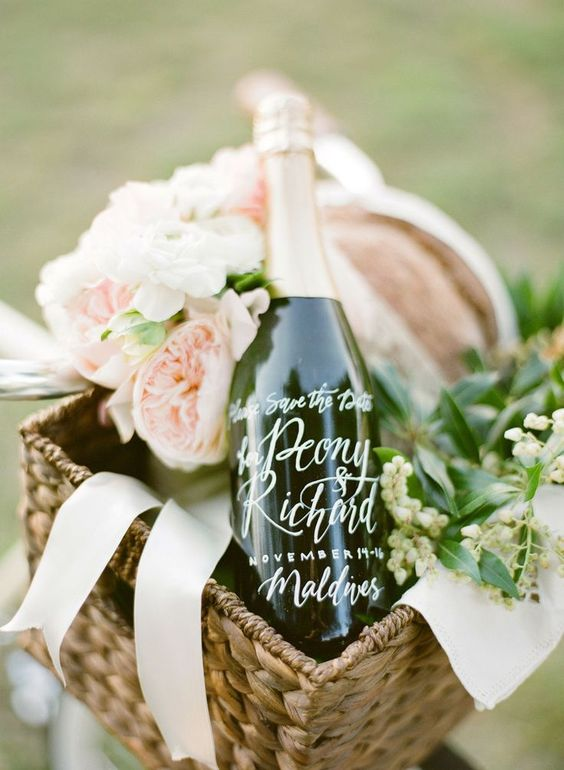 romantic picnic basket with calligraphy champagne bottle save the date