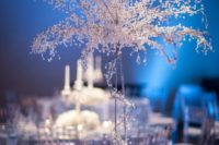 17 silver tables with wire and crystal trees and white flowers