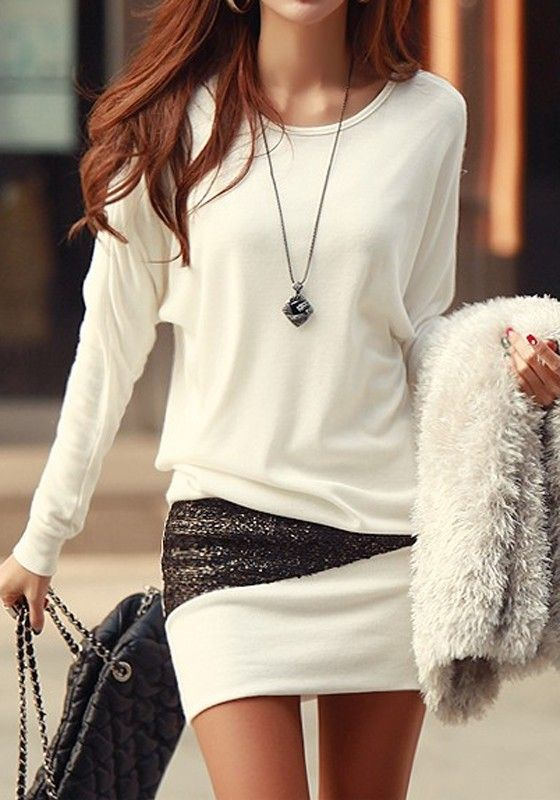 white sweater, a white and sequin mini skirt and a necklace