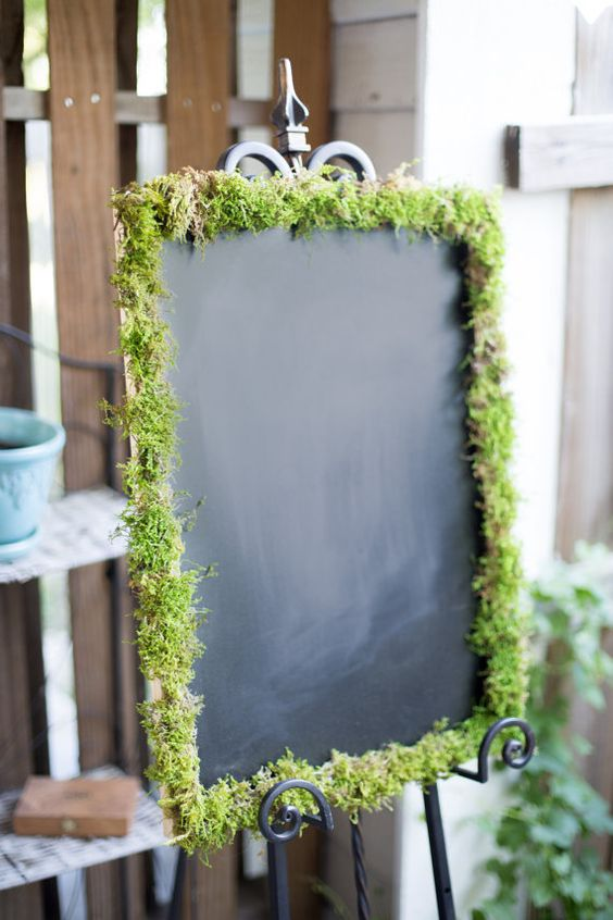 chalkboard with moss as a guest book