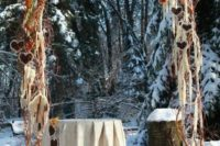 18 frosted outdoor winter arch with orange flowers and fabric hearts hanging