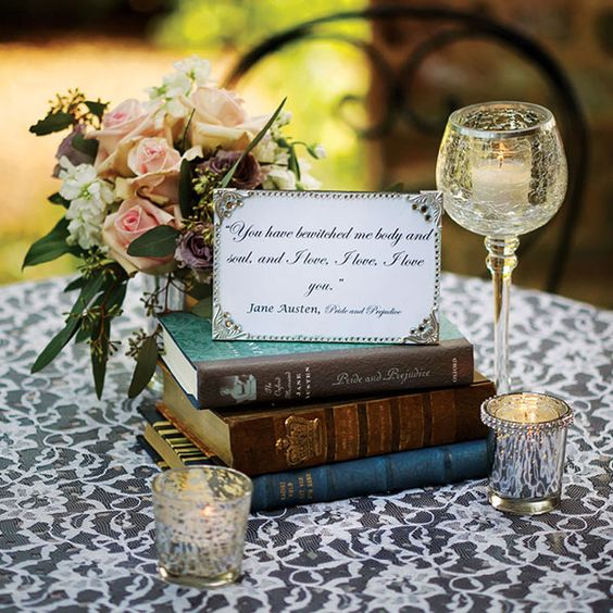 place a stack of classic love stories on each table, with a framed quote on top