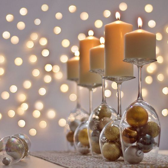 turn over large glasses and put ornaments inside and candles atop