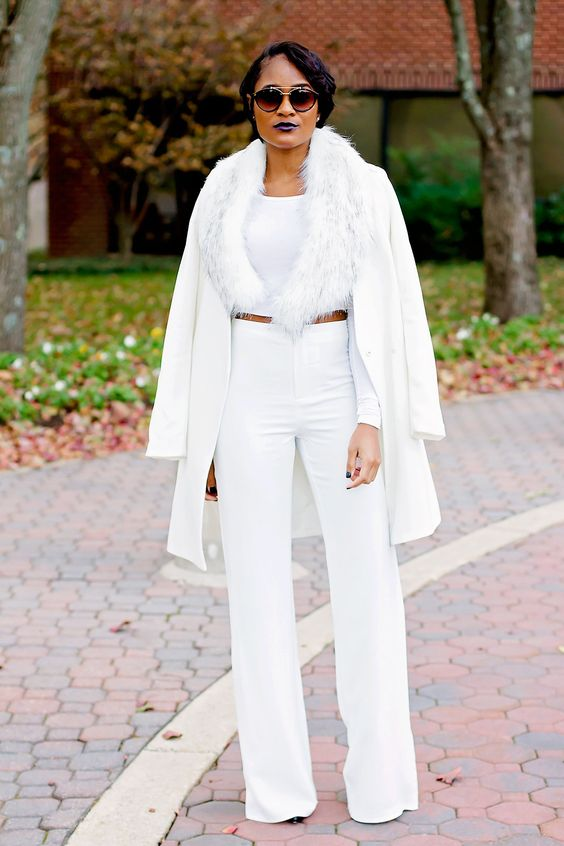 all-white look with wide leg pants, a crop top, faux fur and a jacket