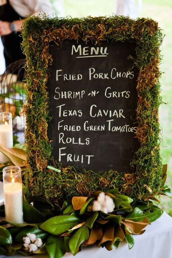 moss covered chalkboard menu sign
