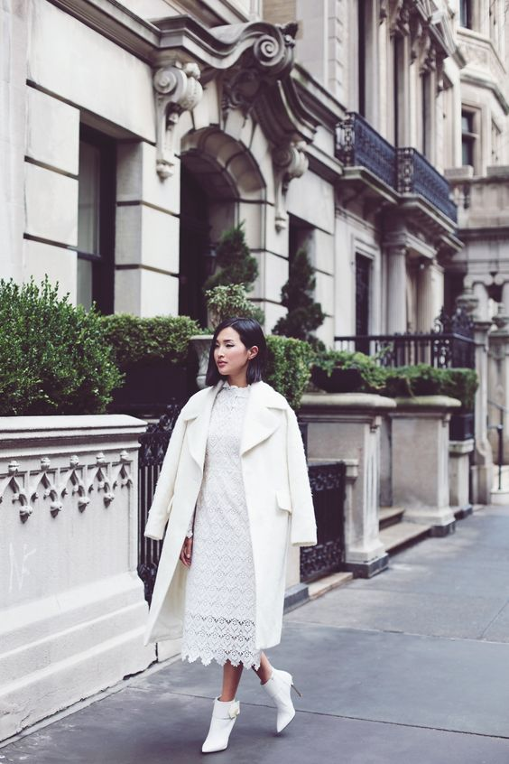 all-white outfit with a lace midi dress, ankle booties and a warm coat