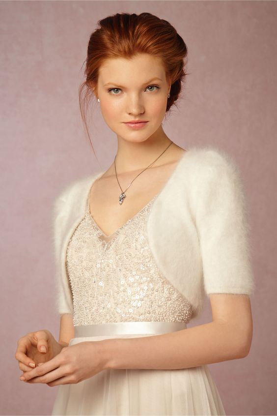 ivory angora bolero will keep your shoulders warm and match many wedding dresses