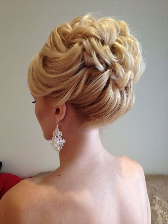 wavy hair pulled up into a braided wedding hairstyle