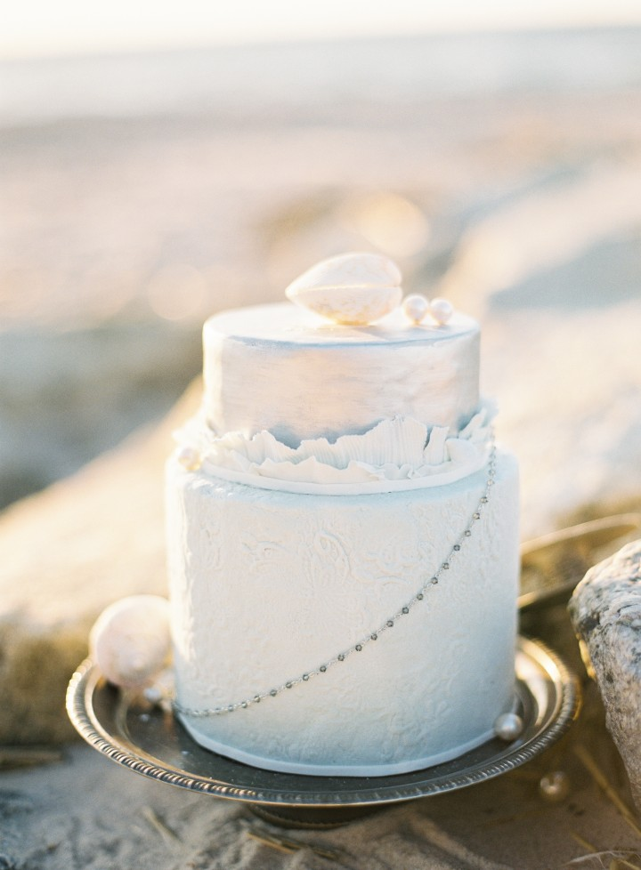 white winter coastal cake decorated with shells and pearls