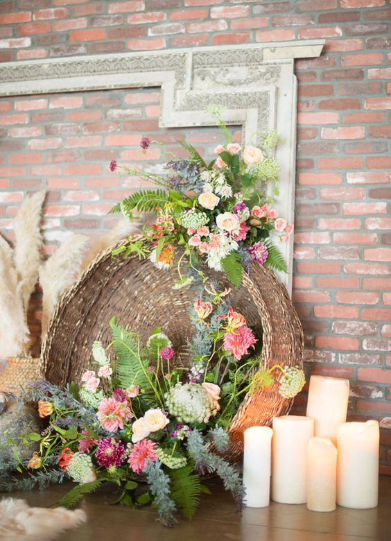 boho basket filled with florals and greenery as a wedding decoration