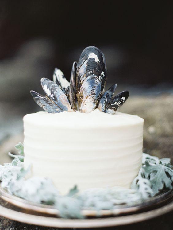 coastal wedding cake decorated with oyster shells